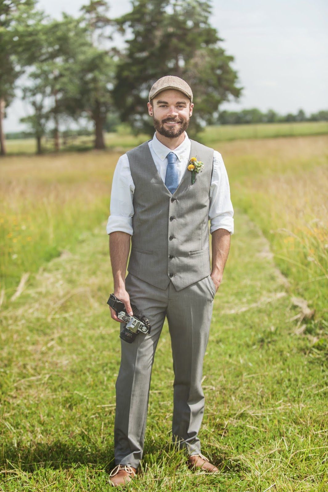 Vintage photographer groom