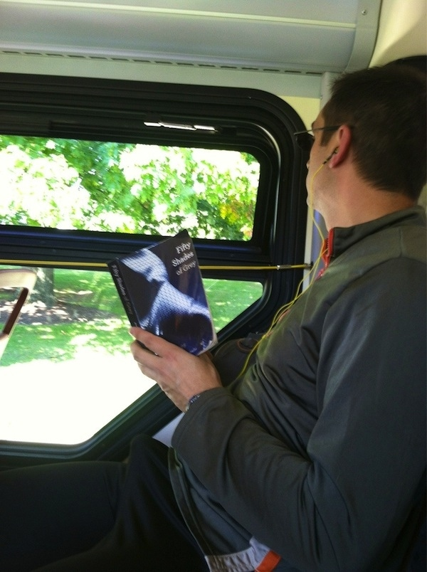 guy reading 50 Shades of Grey with a boner