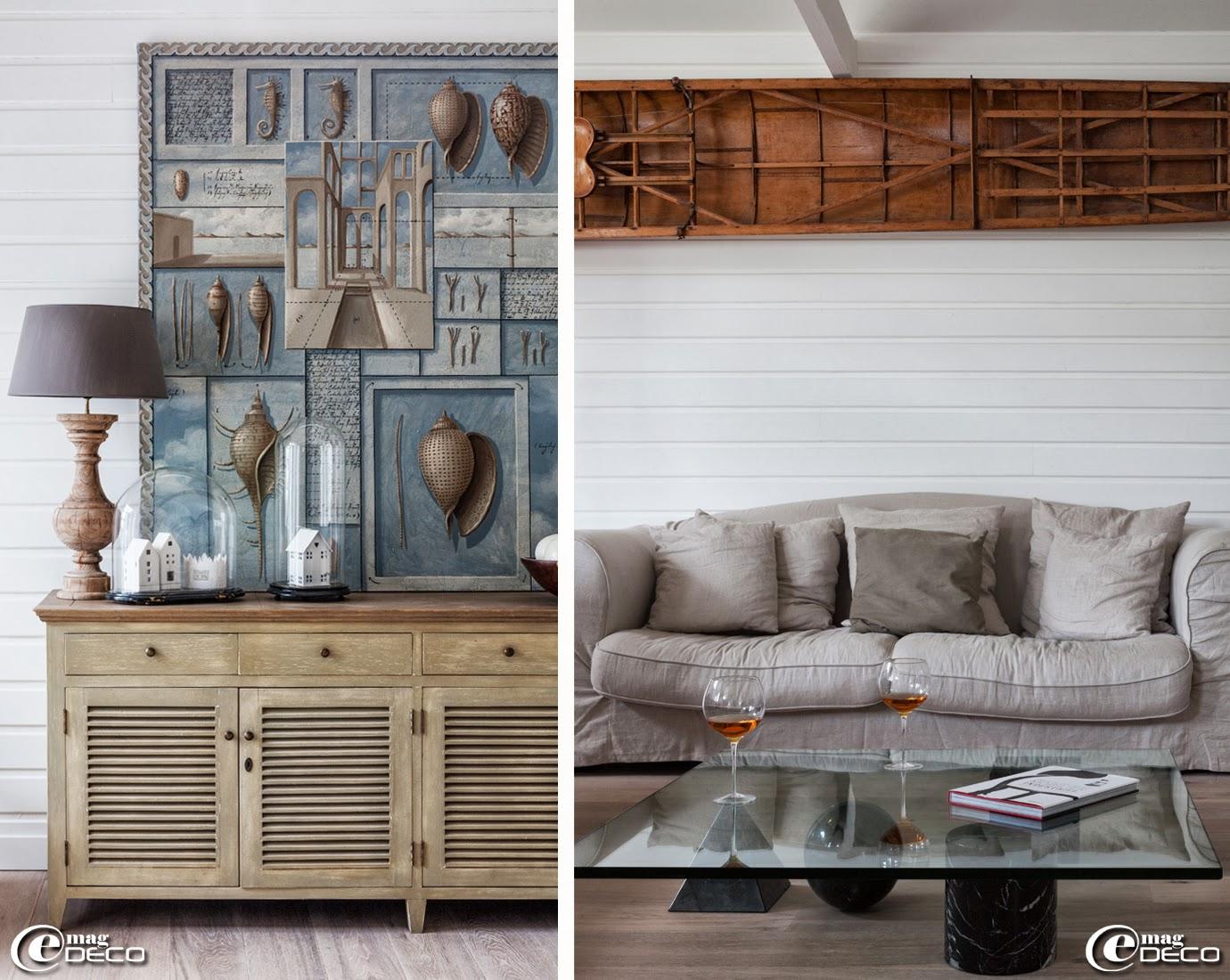 Simplement posé sur un buffet en bois, un tableau d'Eric Peyret. Dans un salon, une table basse 'Metafora' dessinée par Lella et Massimo Vignelli, accroché au mur, un skif chiné chez un antiquaire