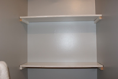 DIY Built-In Bathroom Shelving {rainonatinroof.com} #bathroom #shelving #storage