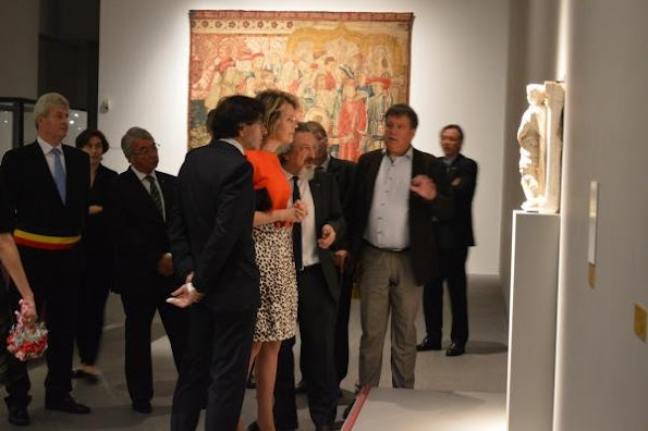 Queen Mathilde of Belgium visits the exhibition 'L'Homme, le Dragon et la Mort, La Gloire de Saint Georges' (The man, the dragoon and the Death, Glory of Saint Georges)