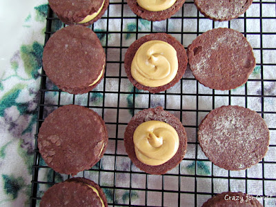 chocolate sandwich cookies with caramel open being assembled