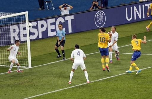 Sebastian Larsson shoots to score Sweden's second goal against France
