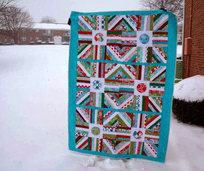 http://quiltyhabit.blogspot.com/2014/01/tgiff-blizzard-finished-quilt.html