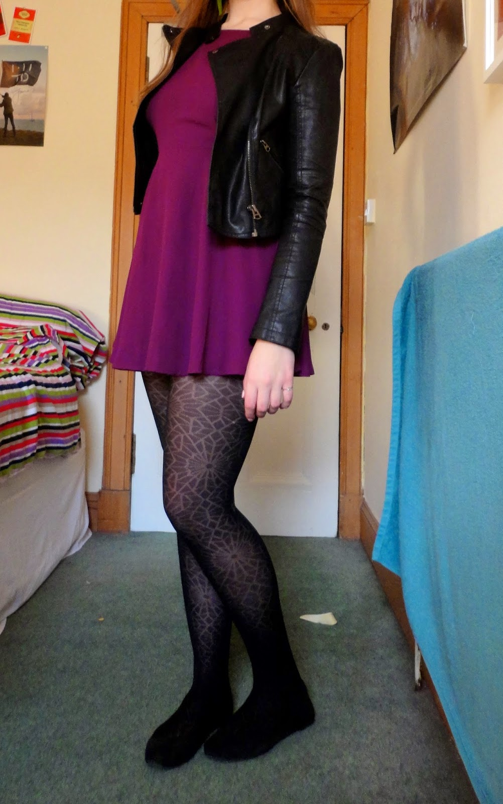 short purple dress with leather jacket, black flats and cobweb tights