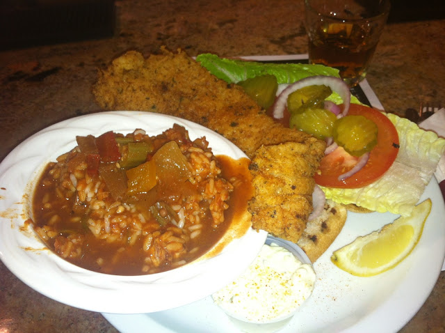 Image of freshly served dinner of deep fried catfish and jambalaya