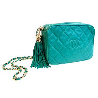 Vintage 1990's turquoise quilted leather Chanel bag with gold chain.