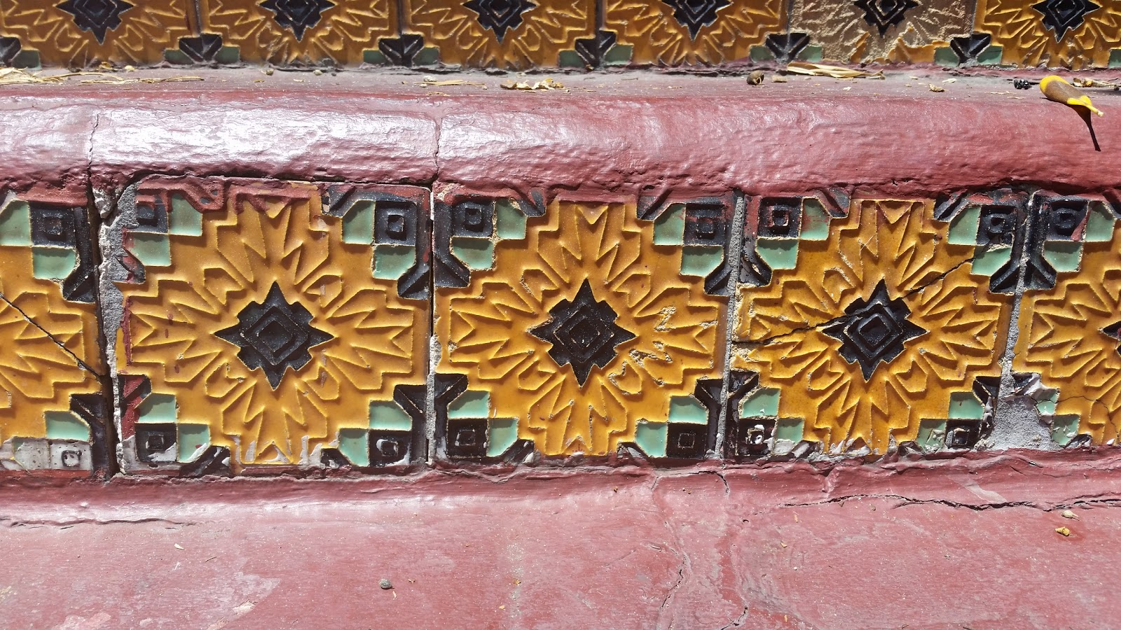 Detail of Sunflower Tiles on stair risers in Beverly Hills circa 1925.