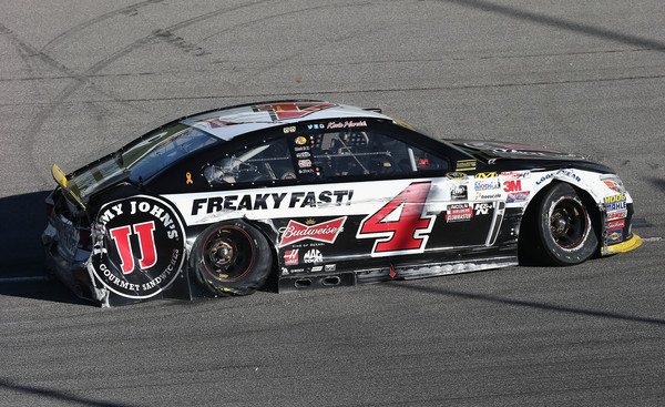 Kevin Harvick, driver of the #4 Jimmy John's / Budweiser Chevrolet, sits on the track with a damaged car after an incident during the NASCAR Sprint Cup Series myAFibRisk.com 400 at Chicagoland Speedway on September 20, 2015 in Joliet, Illinois. (Sept. 19, 2015 - Source: Jonathan Daniel/Getty Images North America)