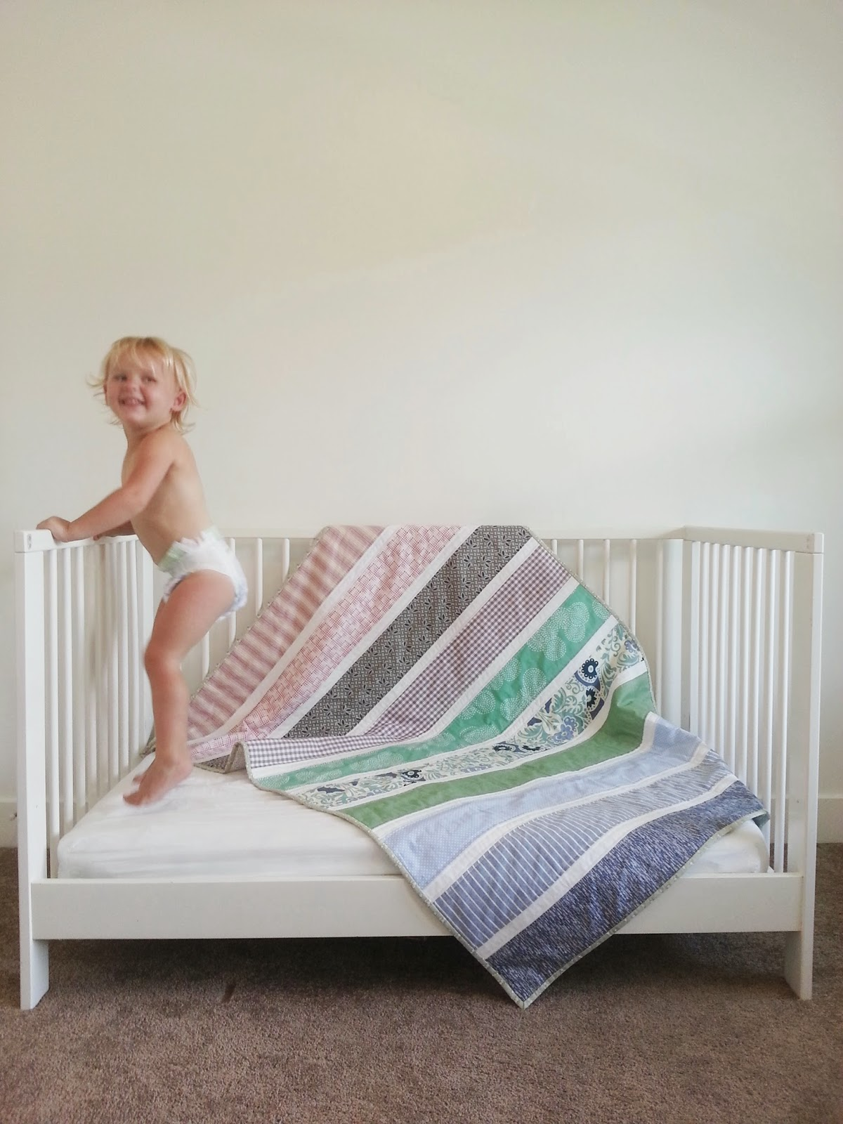 Happy Baby Jumping with Big Stripes Crib Quilt