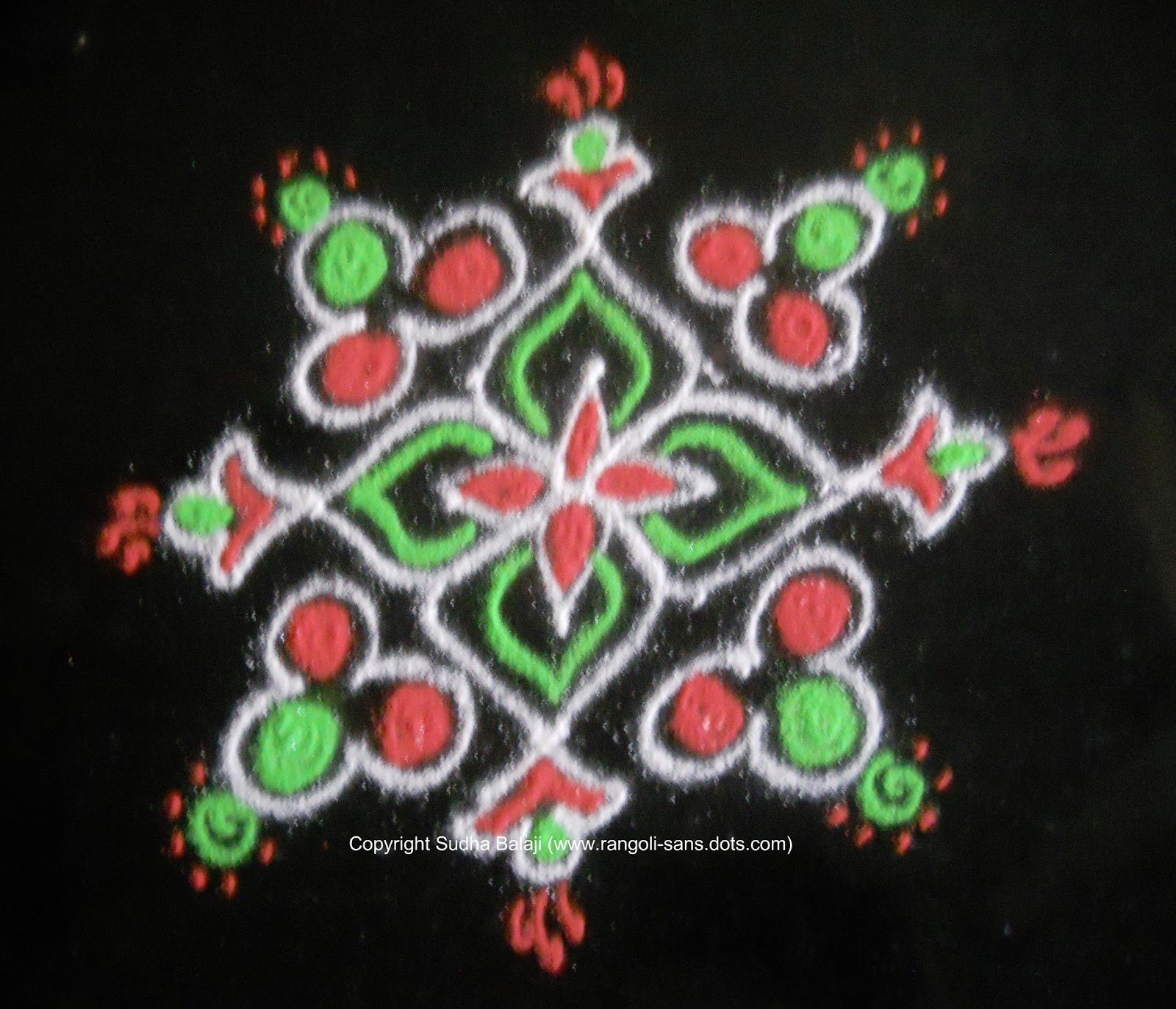 An Easy Rangoli With Dots With Some Patterns And Few Beautiful Colours