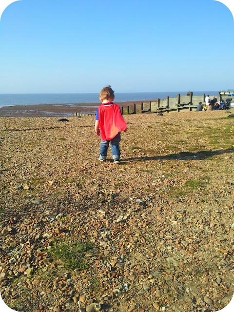 toddler exploring, whitstable beach, toddler pebbles