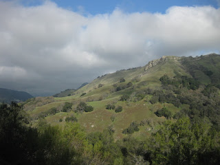 Clouds gather beyond a sunlit hillside along Calaveras Road, Alameda County, California