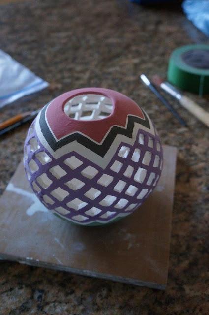 Pierced clay ceramic candle holder vessel in progress.