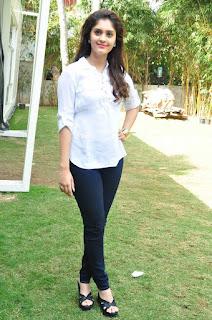 Surabhi Looks absolutley stunning in Whtie Shirt and Denim leggings Lovely Pics