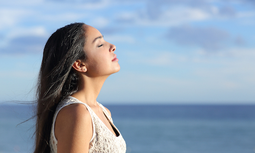 woman practicing healthy breathing