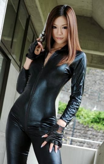 Asian girl in leather with a gun
