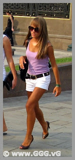 Girl in white shorts on the street