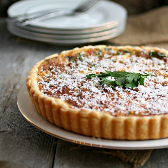 http://www.hungrycouplenyc.com/2014/05/caramelized-onion-tart-brunchweek.html
