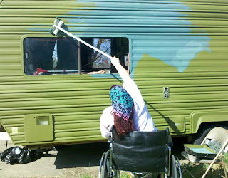 painting from a wheelchair, disabled painters, painting disabled, facing disability challenges, creative paint ideas, overcoming disabilities, painting one love, one love journey 2012, paint day, how to paint a travel trailer