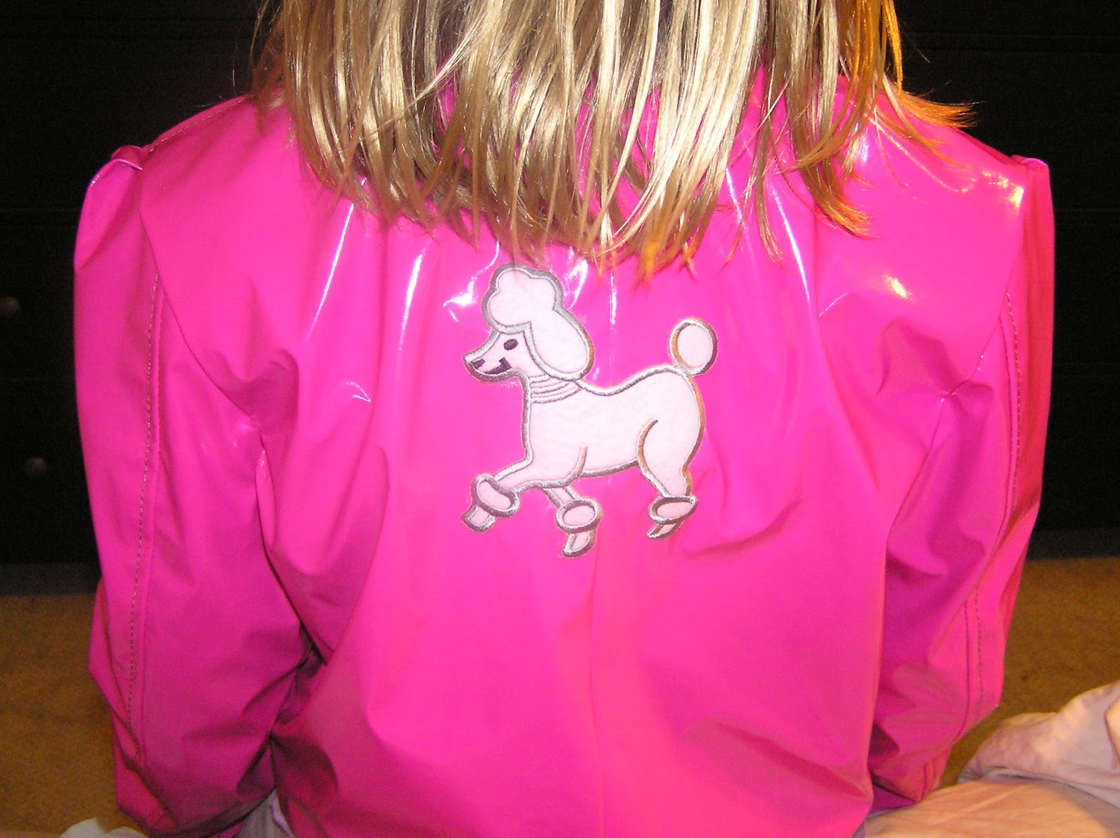 If a motorcycle jacket and a pink poodle Grease-style skirt had a ...