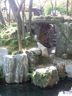 Rock tunnel and park of a stream at the Sorakuen gardens, Kobe