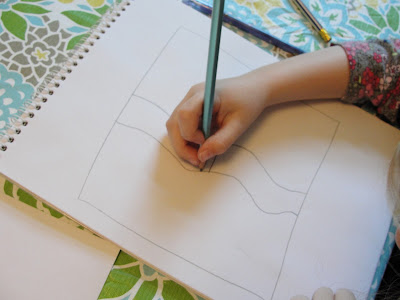 child sketching artwork