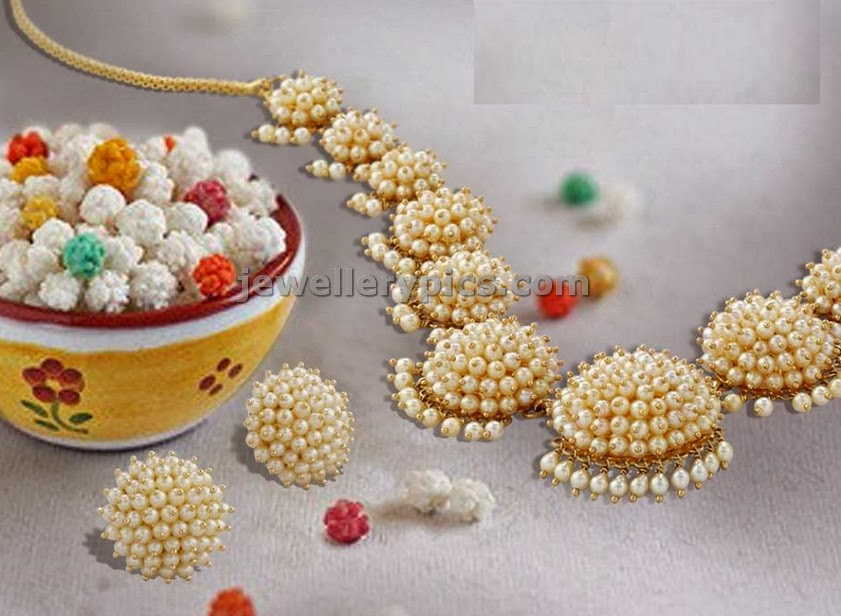 flower pattern necklace and earrings with pearls from lagu bandhu jewellers