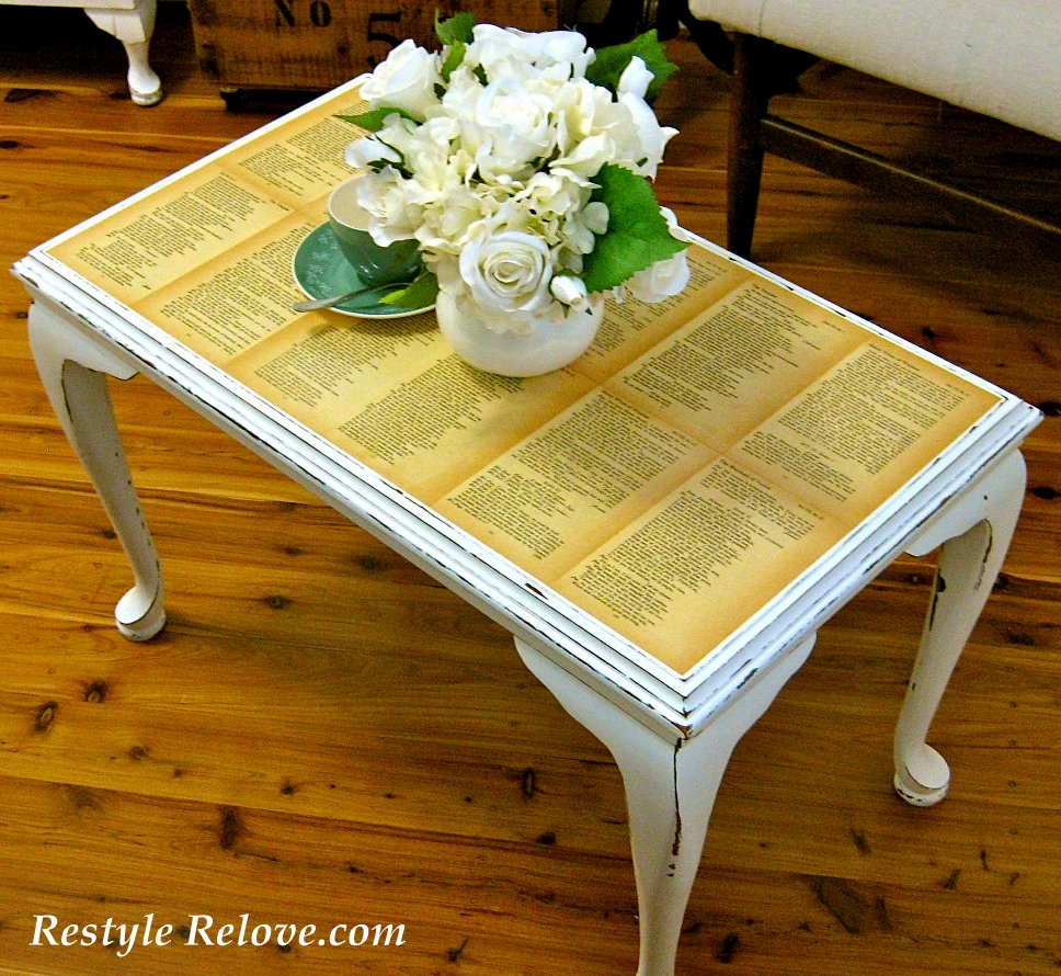 old book page coffee table. Black Bedroom Furniture Sets. Home Design Ideas