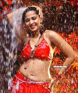 Anushka Shetty in Red Chania Choli spicy Pics