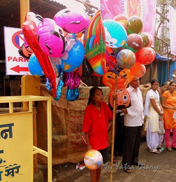 A Balloon seller at the festival of Ganesh Visarjan, Mumbai