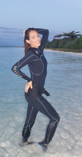 wet suit model on beautiful beach