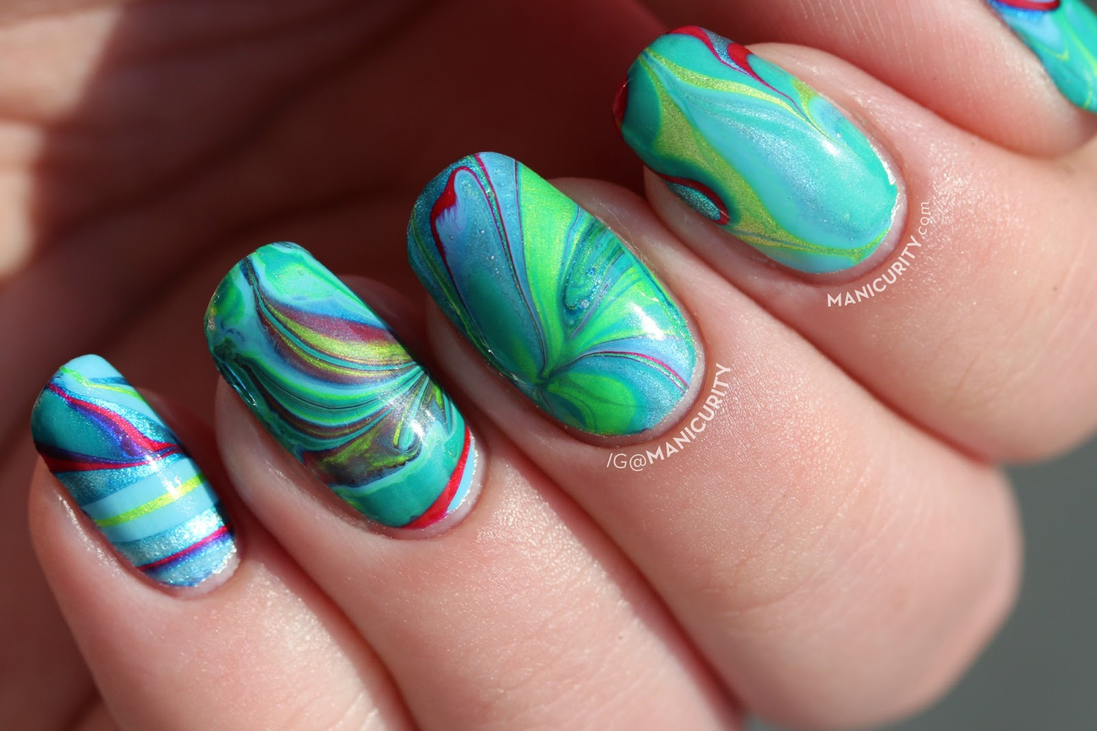 Green Conure Parrot Inspired Watermarble Nails with China Glaze Polishes - with a must-read tip for successful water marbling! | Manicurity.com