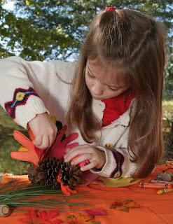 little girl making craft turkey