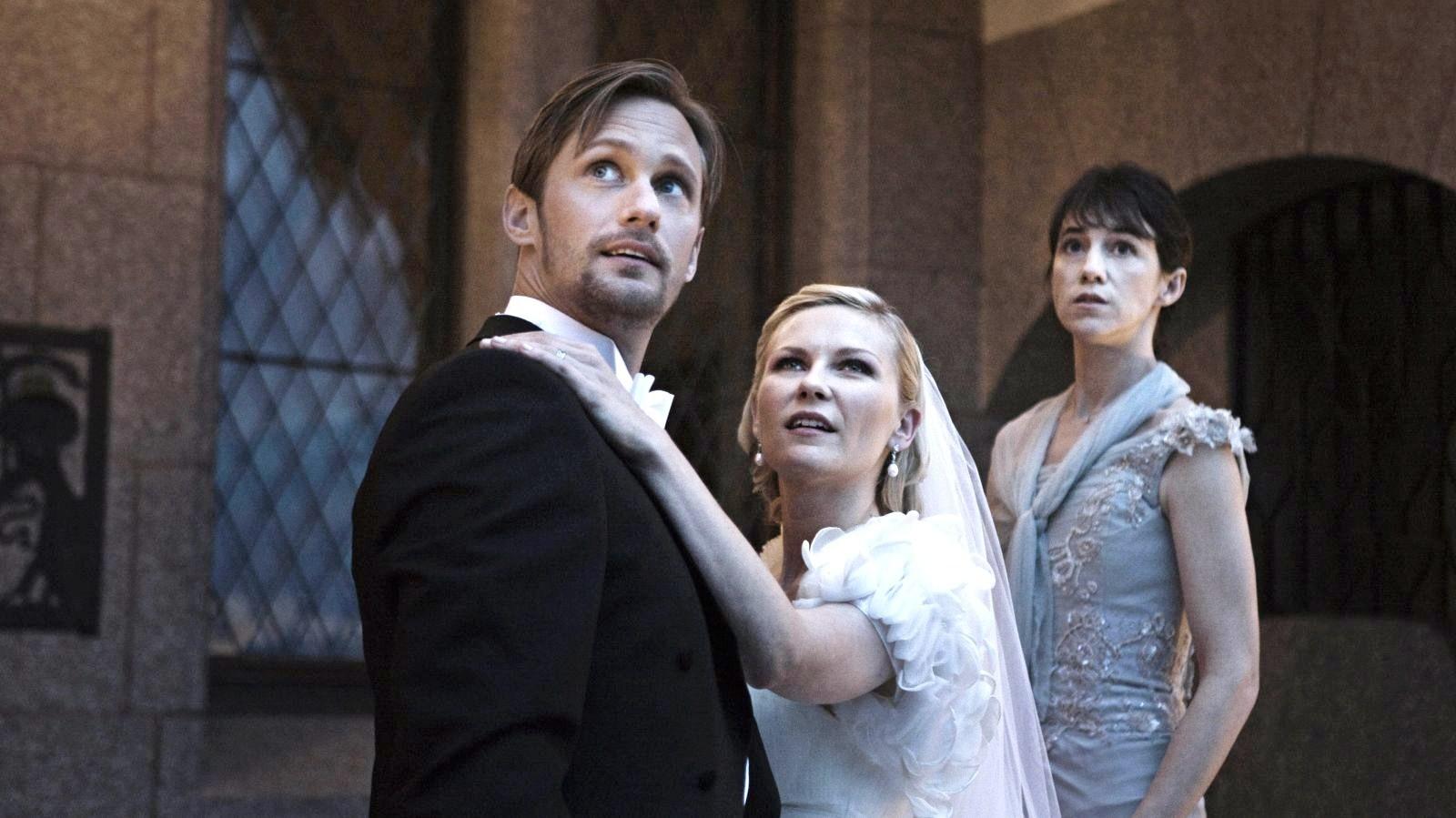 http://1.bp.blogspot.com/-T6tWuyhEmcs/TprmKcZzshI/AAAAAAAAGOA/xIwCNE5TyCc/s1600/melancholia-movie-Kirsten-Dunst_Alexander-Skarsgard_Charlotte-Gainsbourg-16.jpg