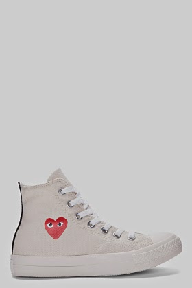 http://www.ssense.com/women/product/comme_des_garcons_play/high-top_cream_canvas_converse_sneakers/88300
