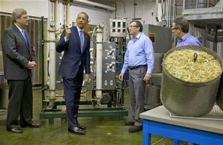 In this Feb. 7, 2014 file photo, Agriculture Secretary Tom Vilsack, left, and President Barack Obama, tour the biomass conversion process area at Michigan State University in East Lansing where Obama signed the sweeping farm bill into law last year. Vilsack is expected to unveil a voluntary set of programs and initiatives for farmers, ranchers and foresters Thursday, April 23, 2015 at Michigan State, that build on Obama's efforts to combat global warming _ and do so in ways that don't require approval from Congress. (Credit: AP Photo/Jacquelyn Martin, File)  Click to Enlarge.