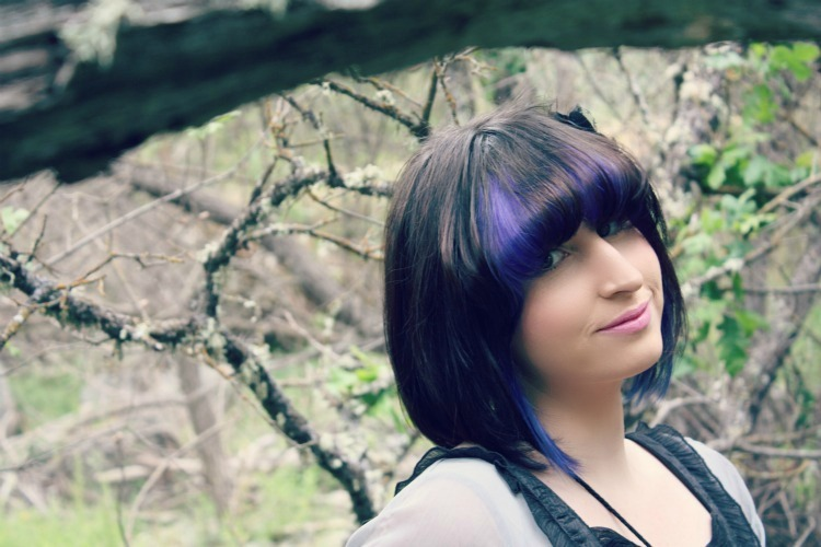 purple highlights purple and black color blocked hair and bangs