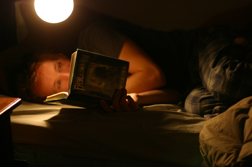 Paul Cram Reading Book in Bed