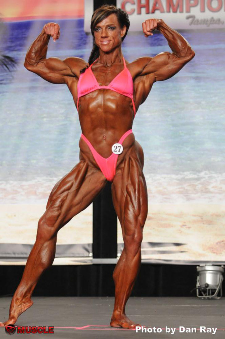 Sheila Bleck Flexing Her Shredded Physique At The IFBB 2012 Tampa Bay Pro