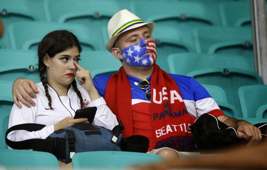 US fans sit in the stands after the World Cup round of 16 soccer match between Belgium and the USA at the Arena Fonte Nova in Salvador, Brazil, Tuesday, July 1, 2014. Belgium won the match 2-1 after extra-time.