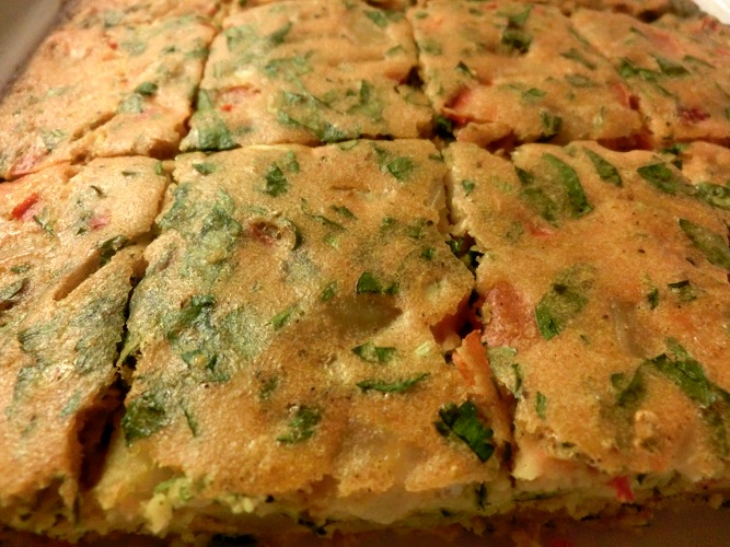 Libyan food ejja libyan omeletfrittata made with chopped potatoes tomatoes chillies and fresh herbs such as coriander or parsley this recipe is traditionally cooked in the forumfinder Choice Image