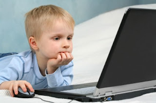 little boy on computer