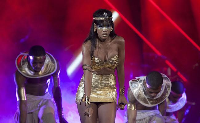 Rihanna as Egyptian princess in a very short dress