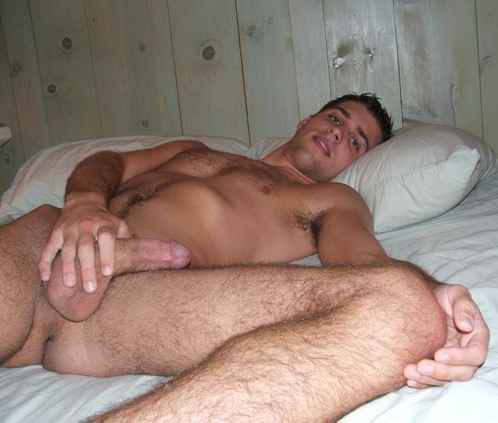 laying Big in gay men bed cocks