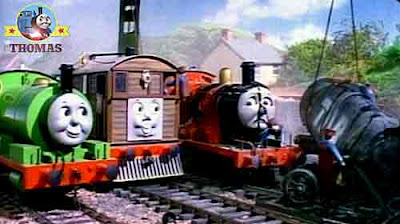 Toby train tram and Percy the small engine with steam locomotive James the splendid engine in a mess