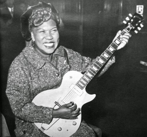 Photo of Sister Rosetta Tharpe with a guitar