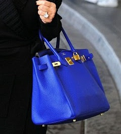 Kris Jenner carries the new Kardashian must-have item... a cobalt ...