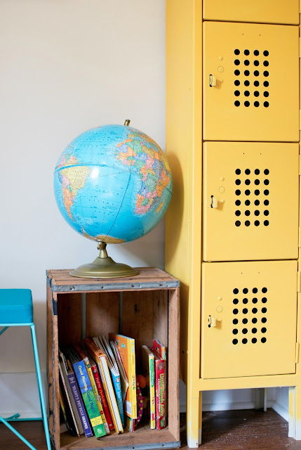 Globe, thrifted crate as bookshelf, and yellow lockers
