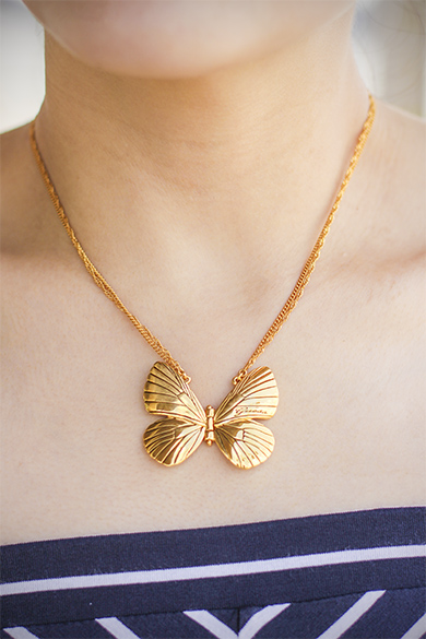 Guess gold butterfly necklace